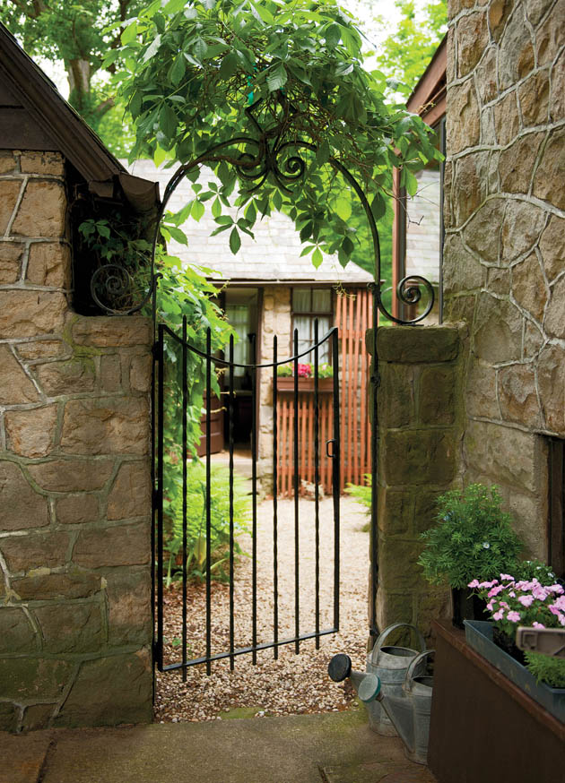 Antique-looking garden fencing helps to set the tone of this home