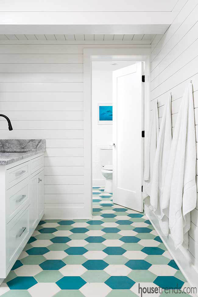 Colorful tile flooring in a pool bath
