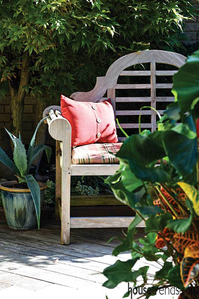 Planters are scattered around a deck