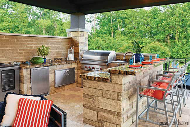 Bar stools add seating to an outdoor kitchen