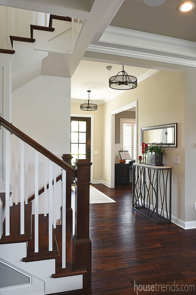 Foyer branches off to multiple living spaces