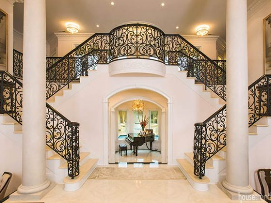 Stair railing dominates the entryway