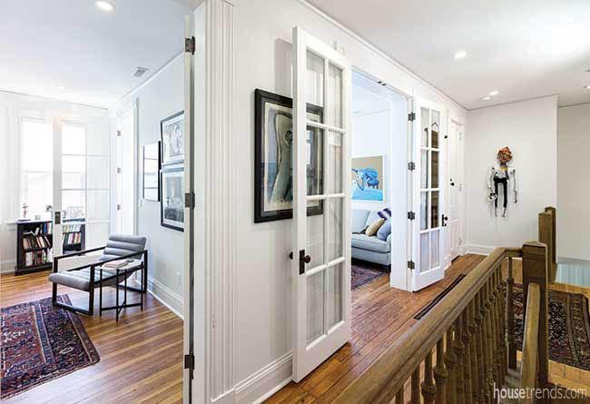 Artwork decorates an upstairs landing