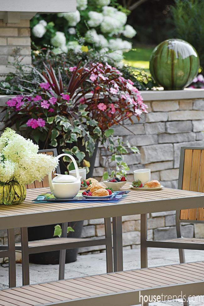 Teak patio furniture complements a simple design