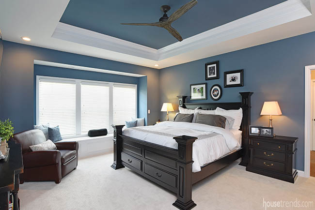Blue walls contribute to a cool bedroom design