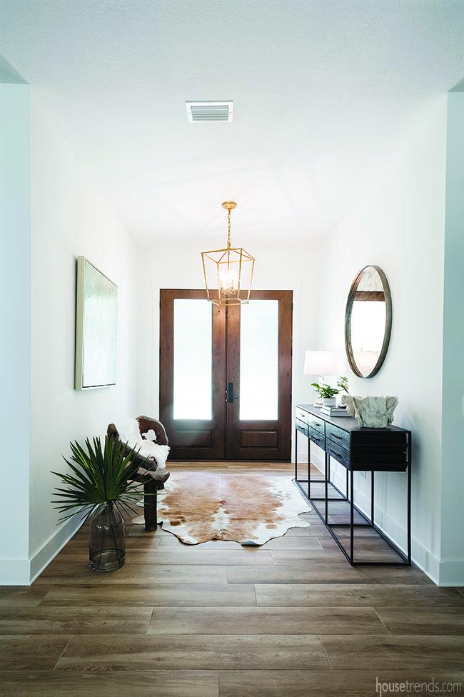 Brass chandelier illuminates an entryway