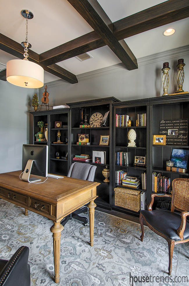 The home office décor in this home complements the custom bookshelf