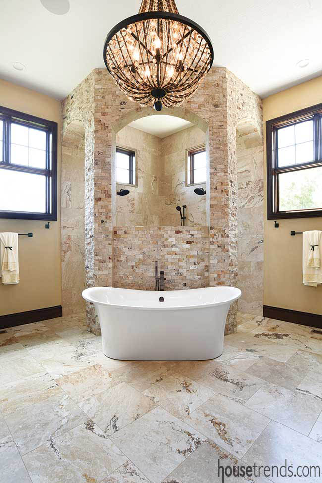 Stacked stone wall hides a walk-through shower