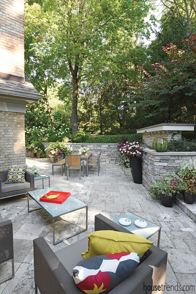 Outdoor furniture adds color to a private sitting area