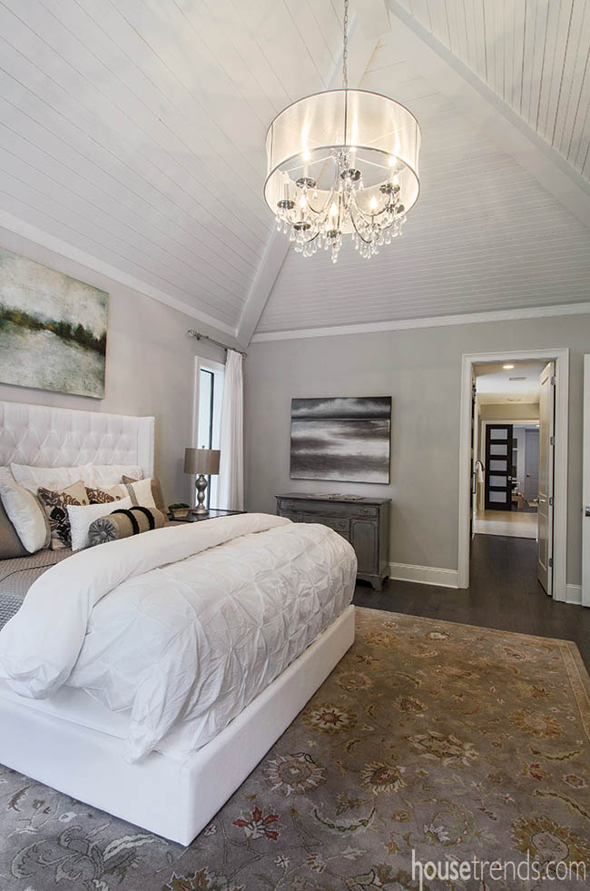 A white platform bed sets the tone in this soothing master bedroom retreat