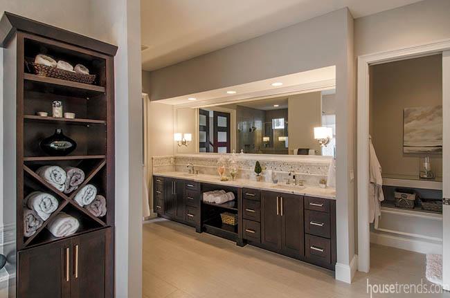 Open shelves create convenient bathroom storage solutions