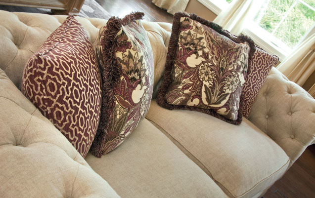 Throw pillows and accessories give off an English vibe