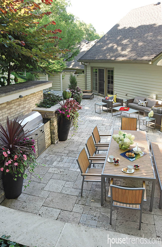 Retaining wall helps define outdoor gathering areas
