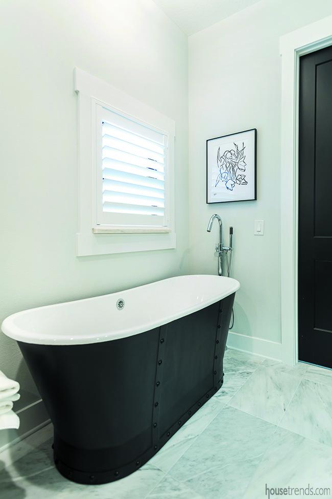 Black bathtub in a master bathroom