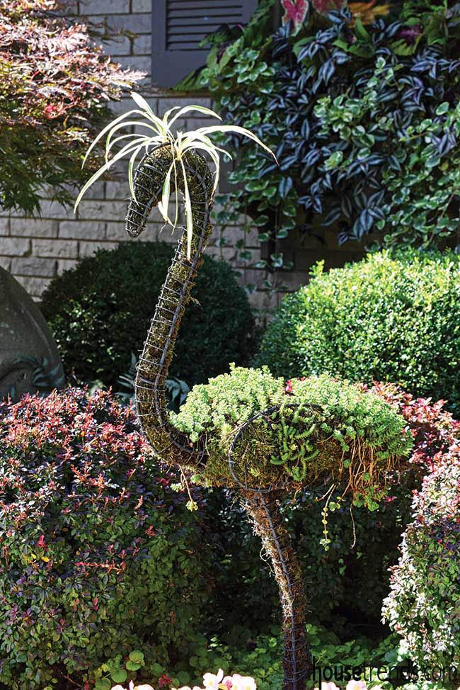 Flamingo topiary in a garden