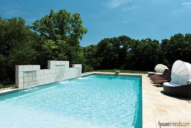 Waterfalls drain into a swimming pool