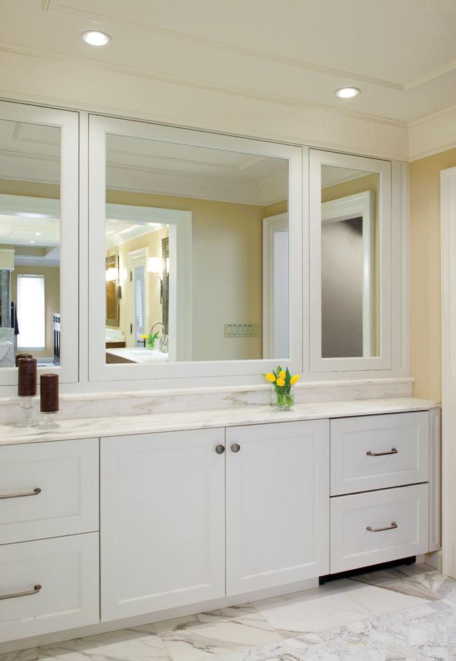 Bathroom mirror cabinets hide coffee bar