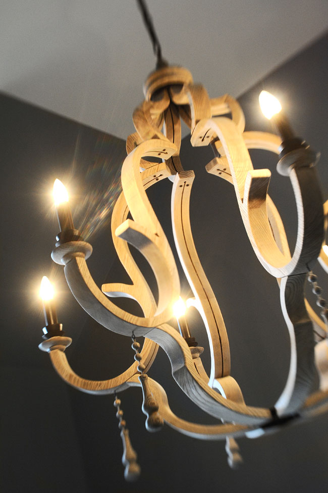 Wood chandeliers pair casual with elegant.