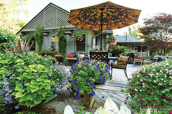 Deck offers gorgeous view of flowerbeds