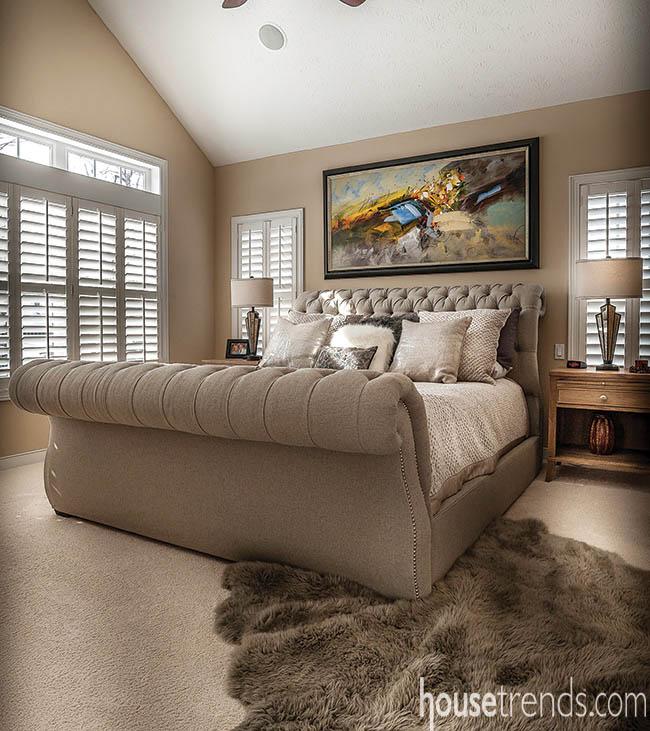 Wall art pops in a bedroom design