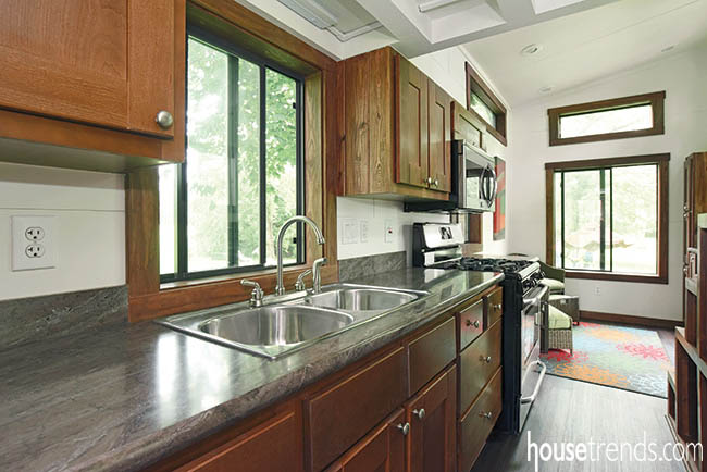 Laminate countertops and cabinetry complete a tiny kitchen