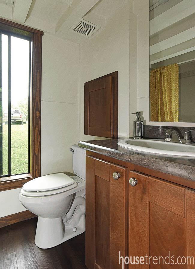 Bathroom vanity creates storage in a tiny house