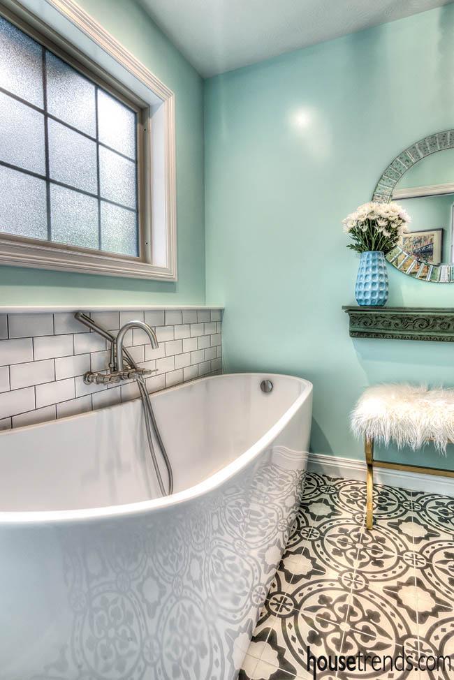 Patterned tile floor pops in a master bath