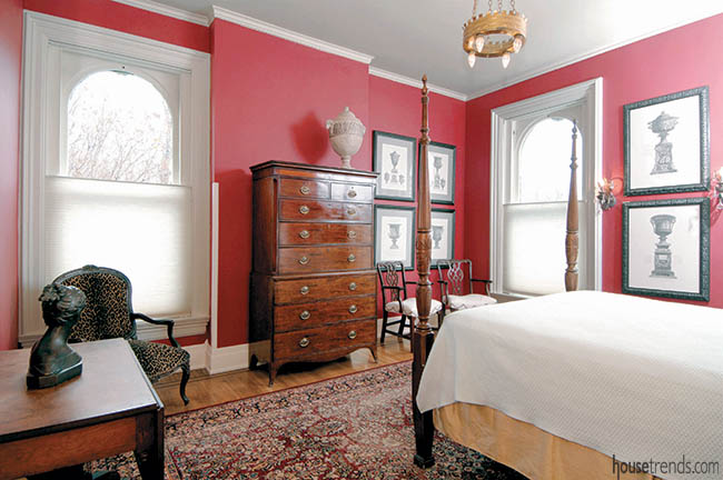 Red walls brighten up a guest bedroom