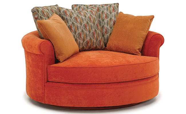 Throw pillows add interest to a lounge chair