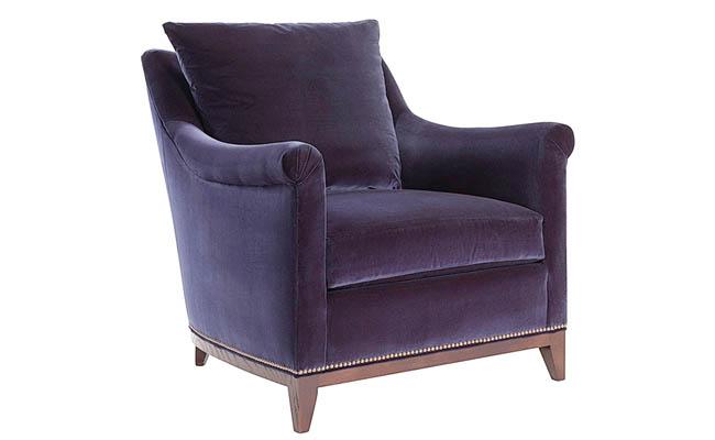 Walnut finish flatters a dark fabric on a chair