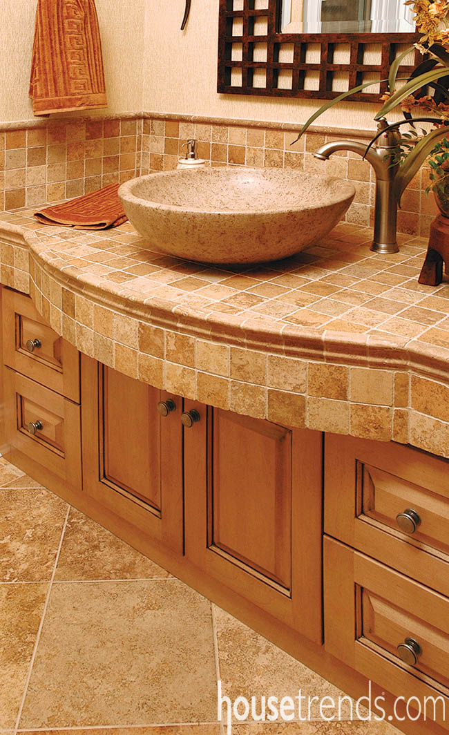 Vessel sink meshes with stone tile vanity