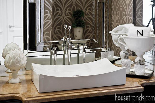 Bathroom mirrors add interest to a powder room