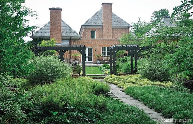 Perennials line a quaint walkway