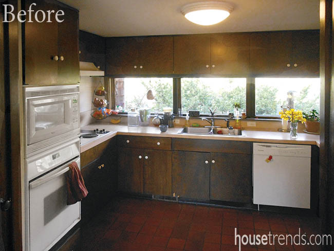 Before picture shows outdated cabinetry and flooring