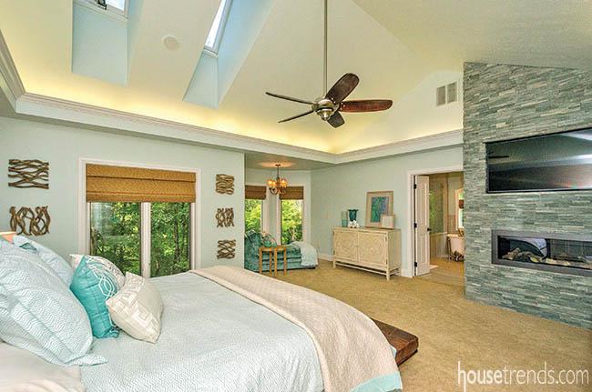Fireplace heats up a bedroom design
