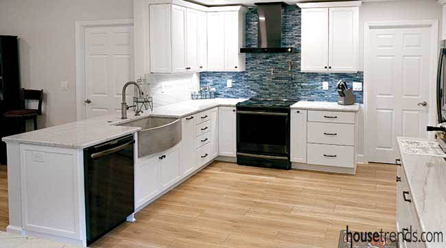 Blue backsplash pops in a white kitchen