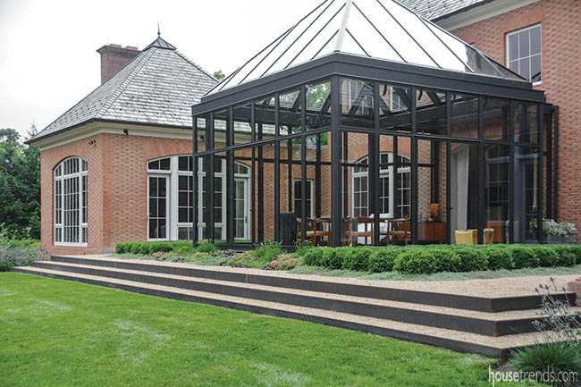 Steps offer a graceful transition from patio to lawn