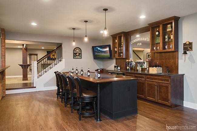 Perimeter cabinetry adds sophistication to a basement bar