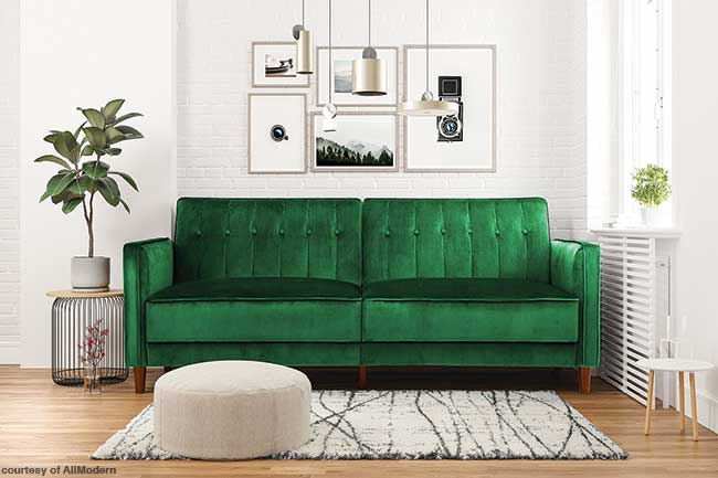 Sofa covered in a luxurious green velvet