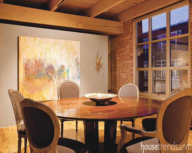 Round dining room table allows for easy conversation