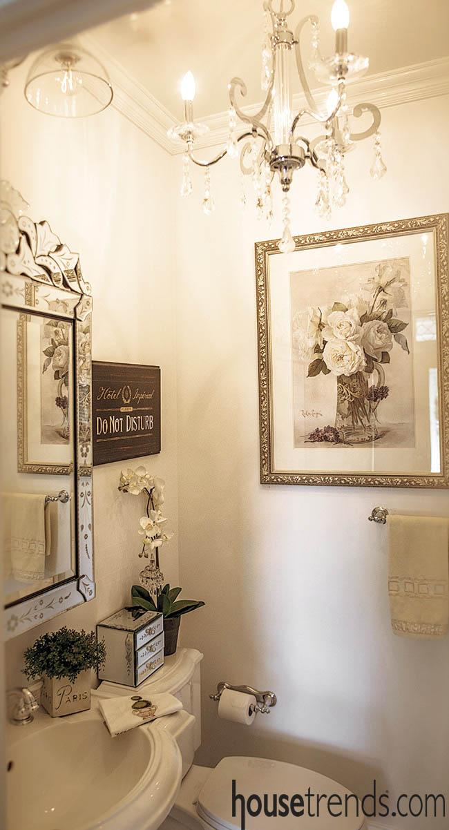 Chandelier complements an elegant bathroom design