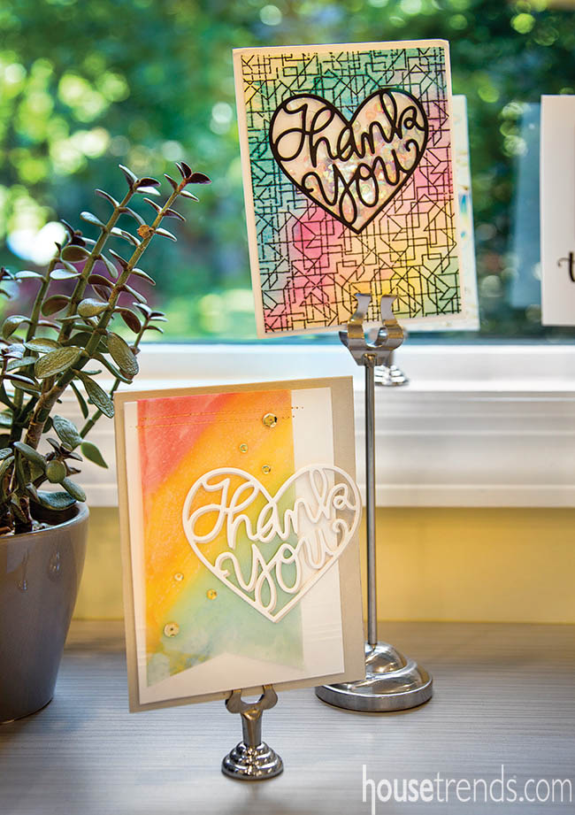 Thank you cards on display in cardmaker's home office