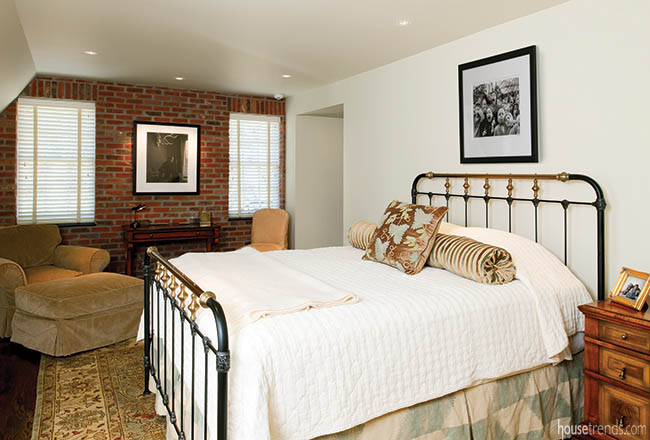 Brick wall adds character to a bedroom design