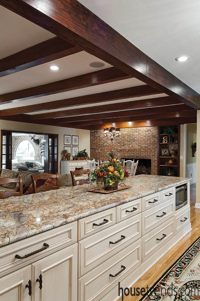 Ceiling beams accent a kitchen design and family room