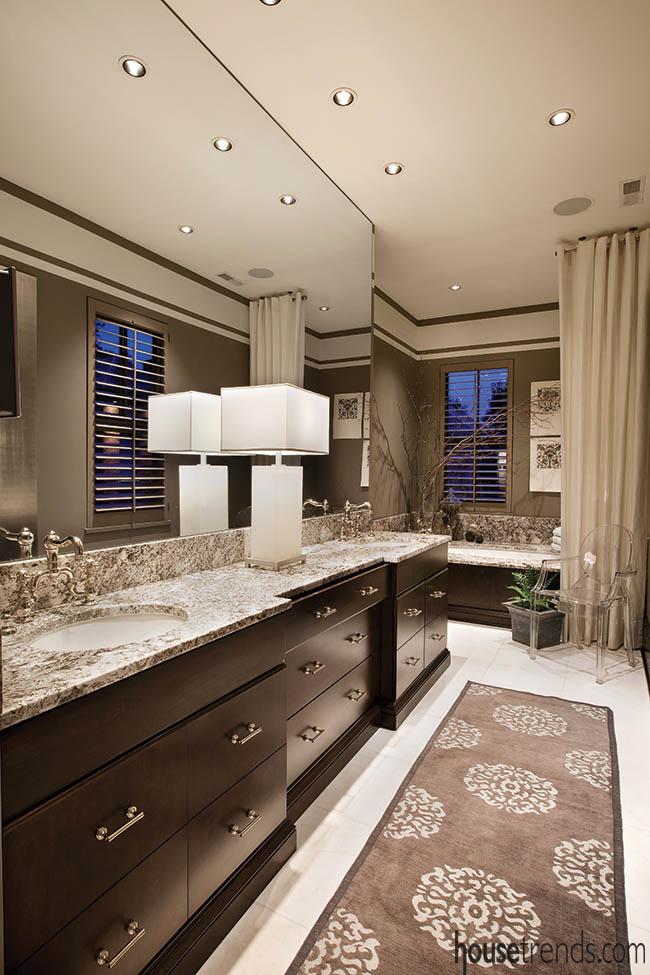 Lamp shines in a dark bathroom design