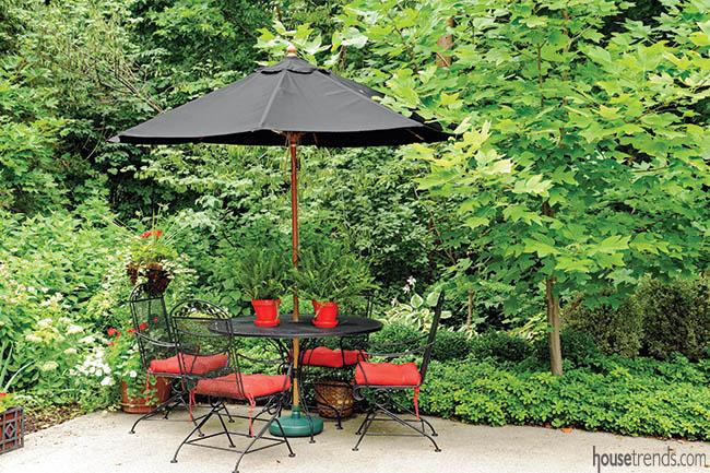 Elegant patio furniture overlooks a garden
