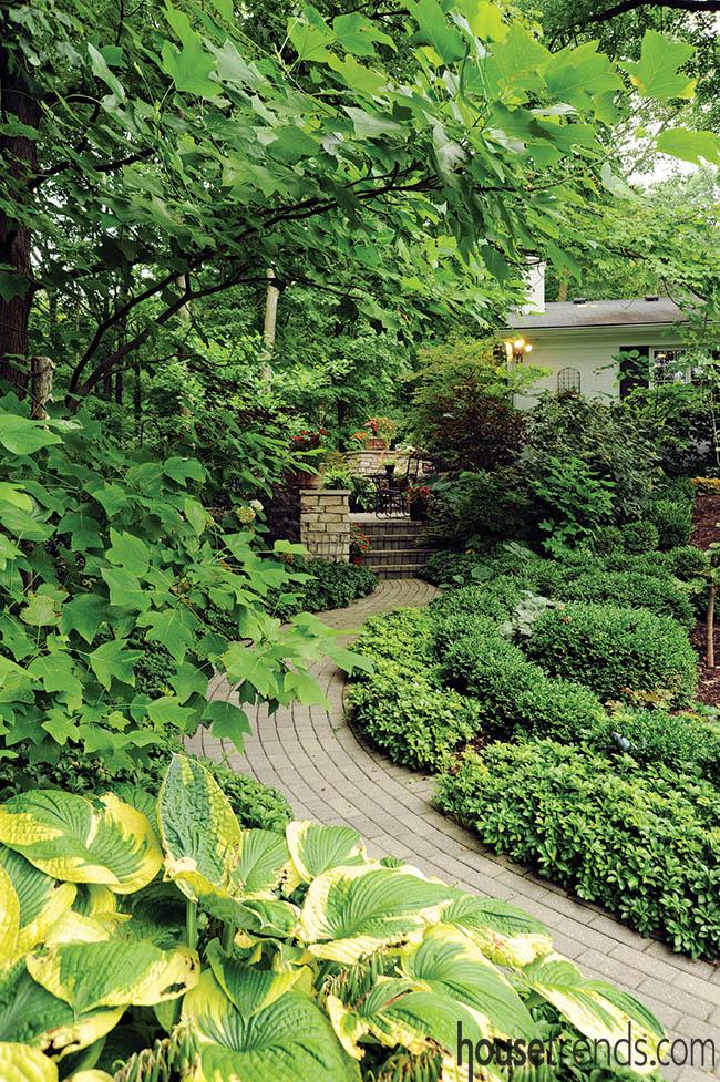 Brick path runs through a garden