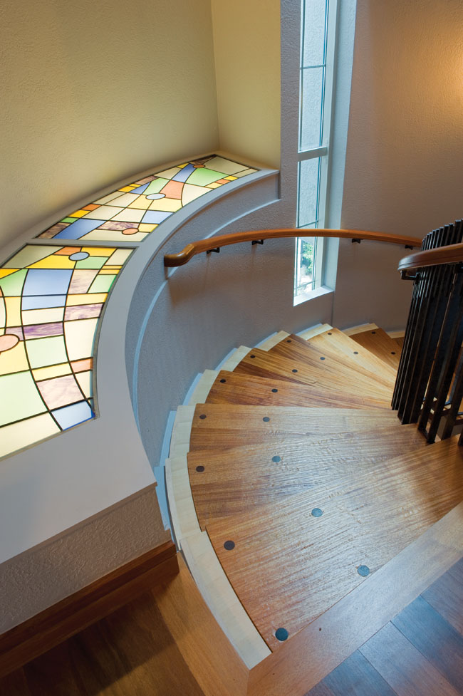 Spiral staircase gets colorful decor