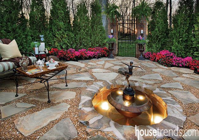 Outdoor water fountain sparkles in a garden design