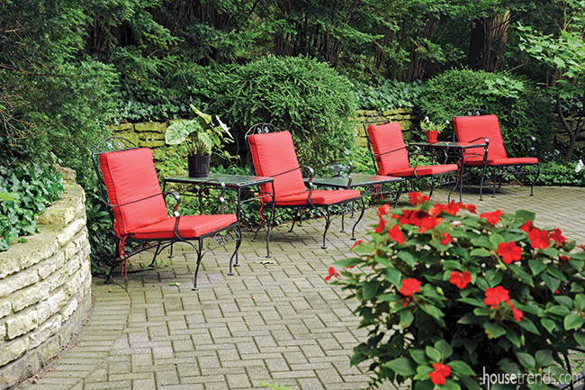 Patio furniture adds color to a garden